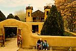 El Santuario de Chimayo, Chimayo, New Mexico, National Historic Landmark, southwest of Taos, 1814-1816, grandmother and granddaughter