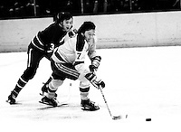 Seals Reggie Leach chased by Canucks Bob Dailey. (1974 photo/Ron Riesterer)