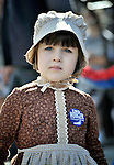 A young participant, wearing a costume, waits the CROP Hunger Walk to begin on October 27, 2013, in Raleigh, North Carolina.