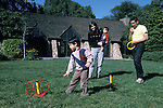 Berkeley CA Family, Mexican father, children ages one and four, playing game on outing to park