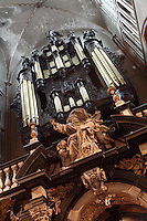 BRUGES, BELGIUM - FEBRUARY 08 : A low angle view of 'God the father' crowned by the organ and the ceiling of the Cathedral of Saint Sauveur (St. Salvator) on February 08, 2009 in Bruges, Western Flanders, Belgium. This sculpture belongs to the rood screen of the cathedral. It is dated circa 1682, in marble, done by Artus II Quellin (Quellinus), and considered as a master piece of he Baroque style sculpture. The cathedral was started in 1280 and was ended in 1350. It is one of the largest and oldest churches in Bruges. (Photo by Manuel Cohen)