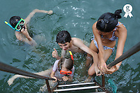 Children in water holding ladder (Licence this image exclusively with Getty: http://www.gettyimages.com/detail/83154169 )