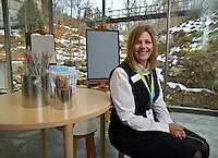 NWA Democrat-Gazette/BEN GOFF -- 02/23/15 Jennifer Dunham, volunteer services manager at Crystal Bridges Museum of American Art, poses for a photo at the museum in Bentonville on Monday Feb. 23, 2014. NOTE: 'volunteer services manager' is Dunham's title. She is museum staff, not a volunteer herself.