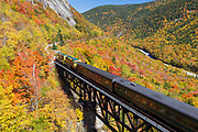 Conway Scenic Railroad - Notch Train crossing the Willey Brook Trestle along the old Maine Central Railroad in Harts Location, New Hampshire during the autumn months. This trestle is within Crawford Notch State Park. And since 1995 the Conway Scenic Railroad, which provides passenger excursion trains has been using the track.