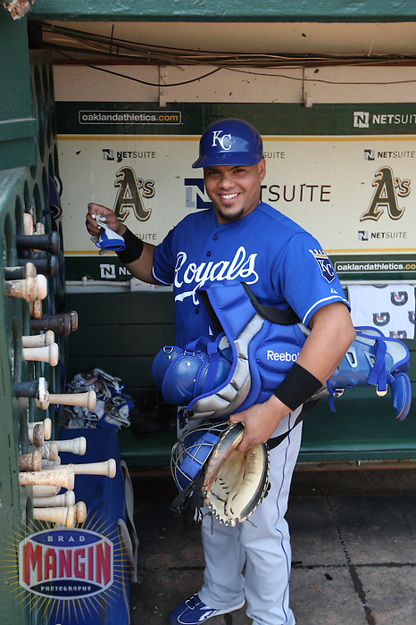 OAKLAND, CA - SEPTEMBER 2:  Brayan Pena #27 of the Kansas City Royals gets ready in the dugout before the game against the Oakland Athletics at the Oakland-Alameda County Coliseum on September 2, 2009 in Oakland, California. Photo by Brad Mangin
