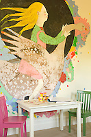 A large mural of a girl riding a swan covers one wall of the child's room
