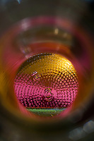 """Beauty at the Bottom: Tequila Sunrise 10"" -  This is a photograph of a tequila bottle shot right down inside of the bottle."