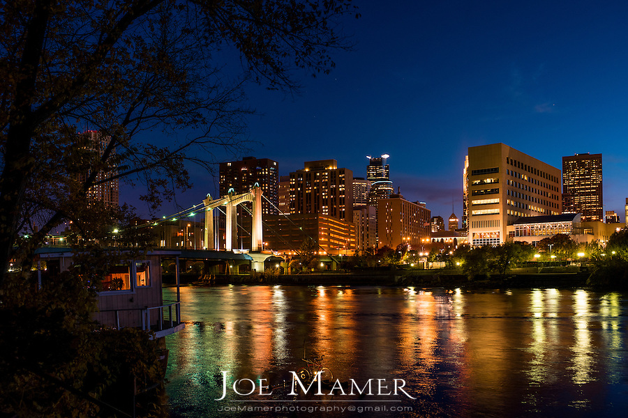 Minneapolis skyline and Mississippi River at dusk.