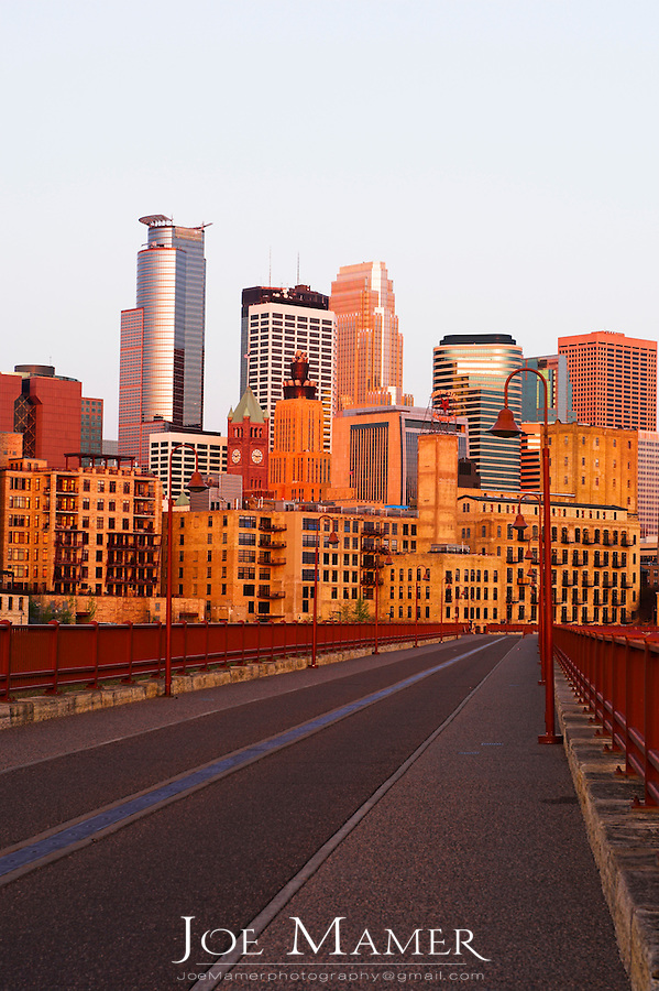 Downtown Minneapolis, Minnesota from the Stone Arch Bridge at sunrise.