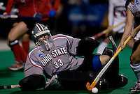Ally Tunitis (33) of Ohio State keeps her eye on the ball as slides for a save during the NCAA Field Hockey Championship semfinals in College Park, MD.  Maryland defeated Ohio State, 3-1.