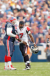 25 September 2005: Michael Vick (7), Quarterback for the Atlanta Falcons, nudges Defensive Tackle Sam Adams (95) after a &quot;roughing the passer&quot; penalty in a game against the Buffalo Bills. The Falcons defeated the Bills 24-16 at Ralph Wilson Stadium in Orchard Park, NY.<br /><br />Mandatory Photo Credit: Ed Wolfstein.