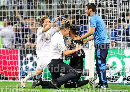 Luka Modrić of Real Madrid, Keylor Navas of Real Madrid celebrate after last penalty shot of Cristiano Ronaldo of Real Madrid at football match between Real Madrid (ESP) and Atlético de Madrid (ESP) in Final of UEFA Champions League 2016, on May 28, 2016 in San Siro Stadium, Milan, Italy. Photo by Vid Ponikvar / Sportida