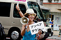 August 6, 2011 - Tokyo, Japan - A professor of Rikyo University takes on the streets during a anti-nuclear rally in Shibuya: August 6 marks the 66th anniversary of the US atomic bombing of Hiroshima in 1945 as Japan still continues to struggle to end the nuclear crisis since the March 11 earthquake and tsunami. (Photo by Yumeto Yamazaki/AFLO)