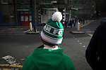 Hibernian 3 Alloa Athletic 0, 12/09/2015. Easter Road stadium, Scottish Championship. A young home supporter in a bobble hat making his way from Easter Road stadium at the conclusion of the Scottish Championship match between Hibernian and visitors Alloa Athletic. The home team won the game by 3-0, watched by a crowd of 7,774. It was the Edinburgh club's second season in the second tier of Scottish football following their relegation from the Premiership in 2013-14. Photo by Colin McPherson.