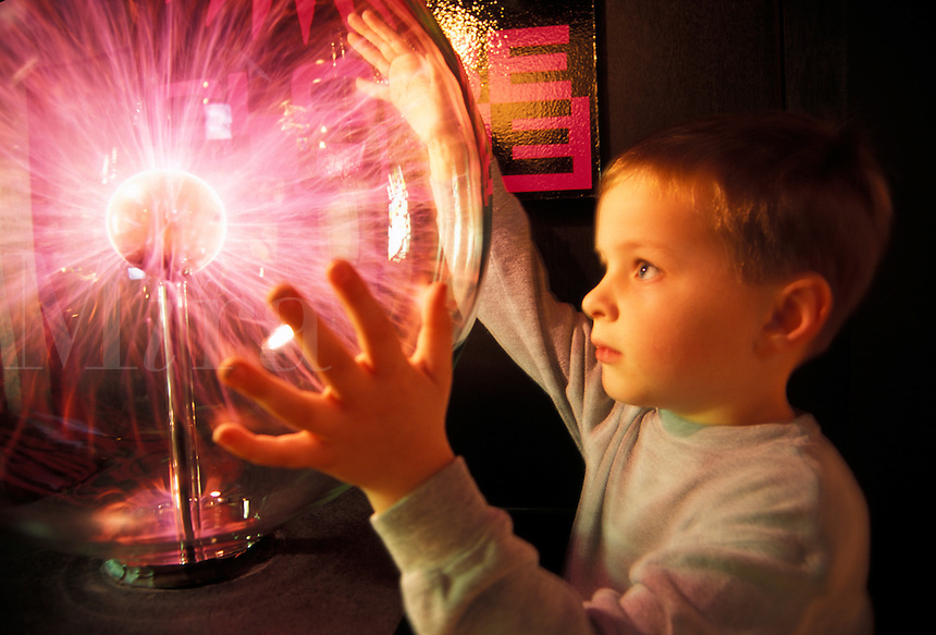 Child at  Plasma Globe display at the Sunrise Museum in Charleston WV, West Virginia