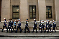 New York, USA. 22nd May, 2014. Members of U.S. Coast Guard Silent Drill Team visit Wall St. during the Fleet Week in New York.  Kena Betancur/VIEWpress