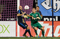 Conor Casey (6) of the Philadelphia Union and Toronto FC goalkeeper Joe Bendik (12). The Philadelphia Union defeated Toronto FC 1-0 during a Major League Soccer (MLS) match at PPL Park in Chester, PA, on October 5, 2013.