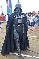 Darth Vader walks along the Santa Monica Pier during Course of the Force on Saturday, July 7, 2012. Course of the Force is an Olympic-style lightsaber relay, where participants are making a journey from Santa Monica to San Diego while benefiting the Make-A-Wish Foundation. At quarter-mile markers (much less than 12 parsecs), participants hand off the official Course of the Force lightsaber to the next runner as they begin their leg of the journey. Course of the Force is taking place July 7-11, in the days leading up to the annual San Diego Comic Con International.