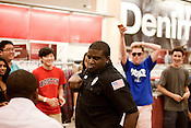August 23, 2012. Durham, North Carolina.. Security guard Brandon Armstrong dances with incoming Duke students.. Super Target welcomed returning Duke University students by busing them to a local store and offering back to school sales and free items.