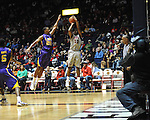 "Ole Miss' LaDarius White (10) shoots over LSU's Ralston Turner (22) at the C.M. ""Tad"" Smith Coliseum in Oxford, Miss. on Saturday, February 25, 2012. (AP Photo/Oxford Eagle, Bruce Newman).."