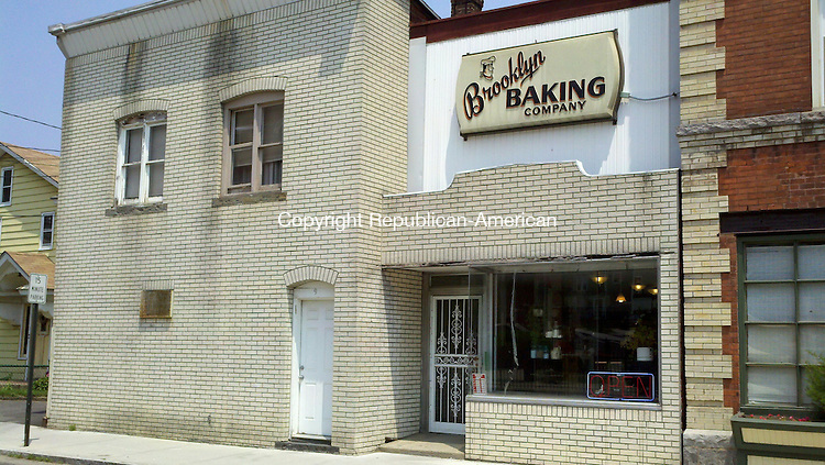 WATERBURY, CT - 01 June 2011 - 060111PO01 - The owner of the Brooklyn Baking Co. in Waterbury has won a $30,000 federal grant to restore the original brick and awning facade of its John Street building. The aluminum siding, stucco and wood should be replaced within the year. Penelope Overton Republican-American