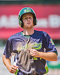 8 July 2014: Vermont Lake Monsters outfielder Scott Masik trots back to the dugout during a game against the Lowell Spinners at Centennial Field in Burlington, Vermont. The Lake Monsters rallied with two runs in the 9th to defeat the Spinners 5-4 in NY Penn League action. Mandatory Credit: Ed Wolfstein Photo *** RAW Image File Available ****