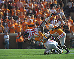 Ole Miss running back Brandon Bolden (34) is tackled by Tennessee linebacker Herman Lathers (34) in a college football game at Neyland Stadium in Knoxville, Tenn. on Saturday, November 13, 2010. Tennessee won 52-14.