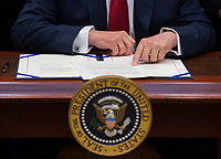 United States President Donald Trump delivers remarks before signing the S. 544 the Veterans Choice Program Extension and Improvement Act in the Roosevelt Room at the White House in Washington, DC on April 19, 2017.<br /> CAP/MPI/CNP/RS<br /> &copy;RS/CNP/MPI/Capital Pictures