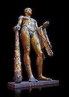 Gilded bronze 1st century AD Roman statue of Hercules found buried near Pompey's Theatre having possibly been struck by lightening and given a customary Roman burial. A Roman copy of a Hellenistic Athenian staue from around 390-370 BC, Vatican Museum Rome, Italy,  black background