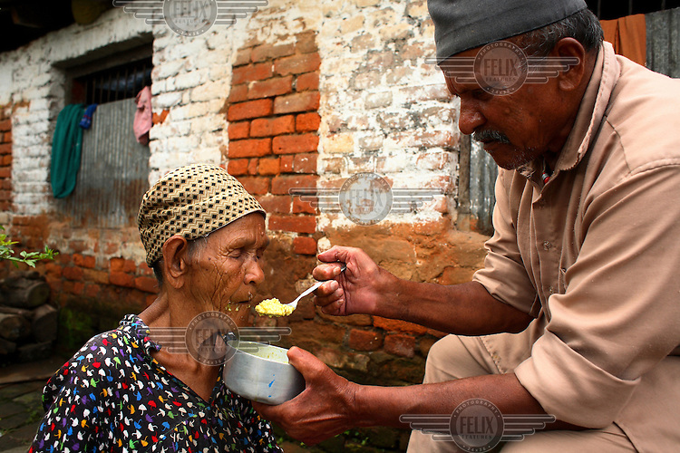 An elderly resident is fed at the Pashupati Bridhashram (old peoples' home). Part of the Pashupatinath Temple complex, the old peoples' home is the largest of its type in Kathmandu, home to 140 women and 90 men. Nepal has a steadily growing elderly population.