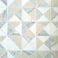 Christopher 2, a hand-cut stone mosaic, shown in honed Carrara, Calacatta, Thassos, and Bianco Antico, is part of the Illusions™ Collection by Sara Baldwin.