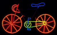 NEON BICYCLE: SCULPTURE BY RUDY STERN<br /> Mixture of Neon &amp; Other Gas Emits Colors<br /> Neon gas produces a red color. Almost every other color is produced using argon, mercury &amp; phosphor coatings. Collection of the Queens Museum, New York; Gift of Mr. and Mrs. Charles Schwartz.