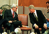 Washington, DC - September 23, 1998 -- The Speaker of the United States House of Representatives Newt Gingrich (Republican of Georgia) invites United States President Bill Clinton to sit beside him during South African President Nelson Mandela's speech accepting the Congressional Gold Medal in the U.S. Capitol Rotunda on Wednesday, September 23, 1998...Credit: Ron Sachs / CNP