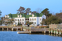 A photograph of Roanoke Island inn on the Manteo waterfront at dawn.