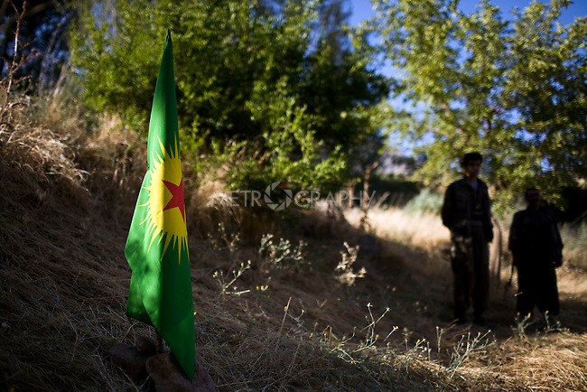 QANDIL, IRAQ: The flag of the Kurdistan Worker's Party (PKK) is planted in the ground of mountain camp in preparation for a interview with PKK acting leader, Murad Qarayilan...The Kurdistan Workers' Party (PKK) is a Kurdish organization fighting for Kurdish autonomy in Turkey.  It is deemed a terrorist group by the USA and the EU. The organization's guerillas are based in the Qandil mountains that make up the border between Iraq and Turkey..Photo by Kamaran Najm / Metrography
