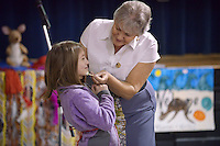 NWA Democrat-Gazette/BEN GOFF @NWABENGOFF<br /> Nellie Beggs of Sydney, Australia paints 3rd grader Sierra Gussman's face before teaching Gussman and three other students an Aboriginal dance for girls Monday, Feb. 13, 2017, during a presentation at R.E. Baker Elementary in Bentonville. Husband and wife Martin and Nellie Beggs have been presenting their 'Australian Kaleidoscope' program at schools in the United States for over ten years for the Kansas City, Mo. company 'The Cultural Kaleidoscope'. Students joined in songs and Aboriginal dances as they learned about the natural and cultural history of 'The Land Down Under' in assemblies and classes throughout the day.