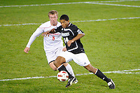 Greg Davis (14) of the Providence Friars is marked by Michael Millay (8) of the Cincinnati Bearcats. The Providence Friars defeated the Cincinnati Bearcats 2-1 during the semi-finals of the Big East Men's Soccer Championship at Red Bull Arena in Harrison, NJ, on November 12, 2010.