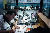 Workers making fine jewelry at the Di Gold Factory workshop in Johari Bazaar in Jaipur, Rajasthan, India.