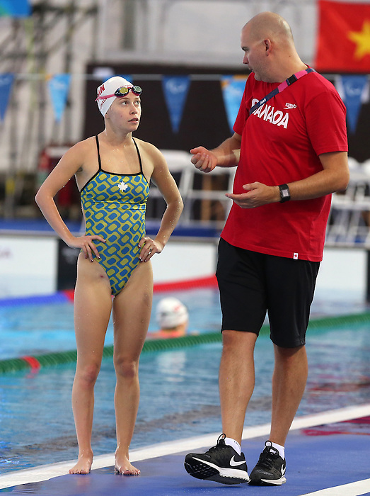 Rio de Janeiro-4/9/2016- Sarah Mehain talks with coach Mike Thompson during training prior to the Rio 2016 Paralympic Games at the Olympic Aquatics Stadium . Photo Scott Grant/Canadian Paralympic Committee
