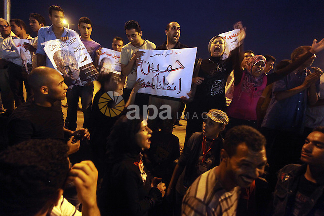 Egyptian protesters shout slogans during a protest against candidate Ahmed Shafiq and support candidate Hamdeen Sabahi, at Tahrir Square in Cairo May 27, 2012. The prospect of Shafiq succeeding Hosni Mubarak as president of Egypt is a nightmare for revolutionaries and Islamists, but a security blanket for those wary of change. Photo by Ashraf Amra