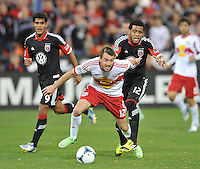 Eric Alexander (12) of the New York Red Bulls goes against D.C. United Raphael Augusto (12) The New York Red Bulls defeated D.C. United  2-0, at RFK Stadium, Saturday April 13, 2013.