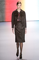 Mirte Maas walks runway in an outfit from the Carolina Herrera Fall 2011 collection, during Mercedes-Benz Fashion Week Fall 2011.