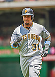 21 June 2015: Pittsburgh Pirates outfielder Jose Tabata trots back to the dugout during action against the Washington Nationals at Nationals Park in Washington, DC. The Nationals defeated the Pirates 9-2 to sweep their 3-game weekend series, and improve their record to 37-33. Mandatory Credit: Ed Wolfstein Photo *** RAW (NEF) Image File Available ***