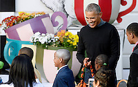 United States President Barack Obama laughs as he hands out treats to a kid who is dressed up as him during a Halloween event at the South Lawn of the White House October 31, 2016 in Washington, DC. The first couple hosted local children and children of military families for trick-or-treating at the White House.<br /> Credit: Olivier Douliery / Pool via CNP /MediaPunch