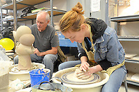 Santa Monica College art students Vanessa Rud and Dave Hall Throw Clay on the Potter's Wheel during the 6th Annual Santa Monica Airport Artwalk on Saturday, March 17, 2012.