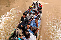 Nepalese and Somali immigrants, heading to the southern U.S. border, travel on a canoe while crossing the jungle of Darién gap in Panama, 30 January 2015.