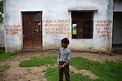 A young boy is seen standing outside the anganwadi centre in the school complex in village Karhai outside of Jhansi, Uttar Pradesh, India. The Indian government spends $1.4 billion a year - on programs that include weighing newborn babies, counseling mothers on healthy eating and supplementing meals, but none of this is yeilding results. According to UNICEF, some 48% of Indian children, or 61 million kids, remain malnourished, the clinical condition of being so undernourished that their physical and mental growth are stunted. Photo: Sanjit Das/Panos for The Wall Street Journal.Slug: IMALNUT