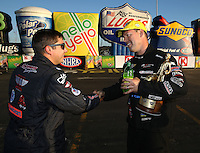 Feb 8, 2015; Pomona, CA, USA; Drew Skillman (left) congratulates NHRA pro stock driver Jason Line as he celebrates after winning the Winternationals at Auto Club Raceway at Pomona. Mandatory Credit: Mark J. Rebilas-