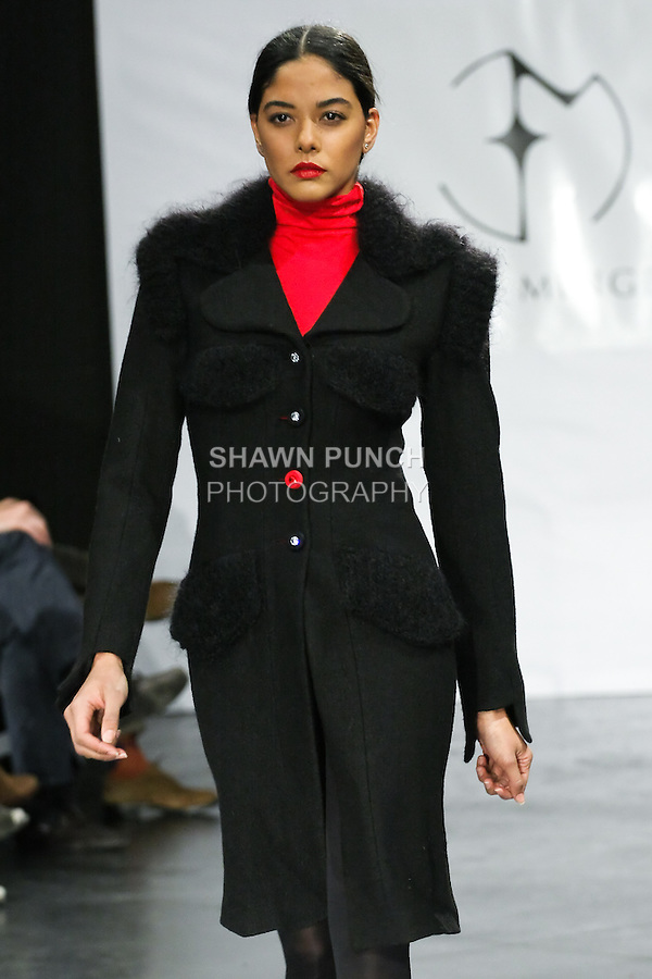 Model walks runway in a DNA Minge range Fall/Winter 2011/2012 collection outfit, by Eva Minge, during New York Fashion Week Fall 2011.