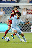 Sporting KC midfielder Roger Espinoza(15) holds off the challenge from Fabian Espindola Real Salt Lake... Sporting Kansas City defeated Real Salt Lake 2-0 at LIVESTRONG Sporting Park, Kansas City, Kansas.
